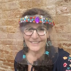 Karen Kubby of Beadology Iowa wearing a beadazzled face shield